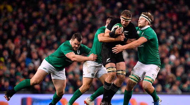 Kieran Read of New Zealand is tackled by Cian Healy, left, Conor Murray and Iain Henderson