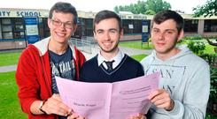 Leaving Certificate students Tomas Janulevicius, Daniel Lyne and Patrick Hajdul after sitting the Physics Honours Paper at Douglas Community School in Cork. Photo: Daragh Mc Sweeney