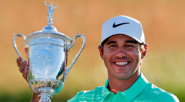 Brooks Koepka with the US Open trophy. Photo: AP