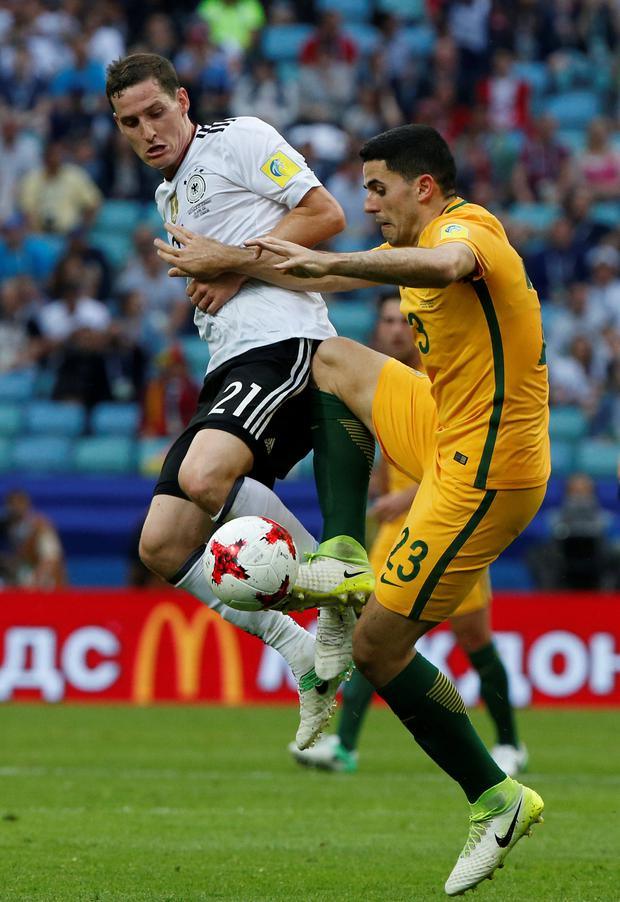 Germany's Sebastian Rudy battles it out with Australia's Tom Rogic during the Group B Confederations Cup match in Sochi yesterday. Photo: Reuters