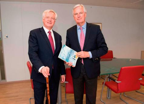 Brexit Secretary David Davis exchanging mountaineering gifts with European Commission's chief negotiator Michel Barnier at the commission's Berlaymont headquarters in Brussels, Belgium. Picture: PA Wire