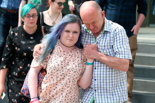 Dominique Meehan with her father William after her attacker, Keith Hearne, was sentenced to 12 years in jail at the Central Criminal Court in Dublin. Photo: Damien Eagers