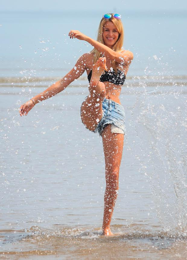Aisling Gale cools off in the water at Portmarnock. Photo: Gareth Chaney Collins