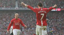 Ronaldo celebrates with Wayne Rooney during his Manchester United days. Photo: Getty