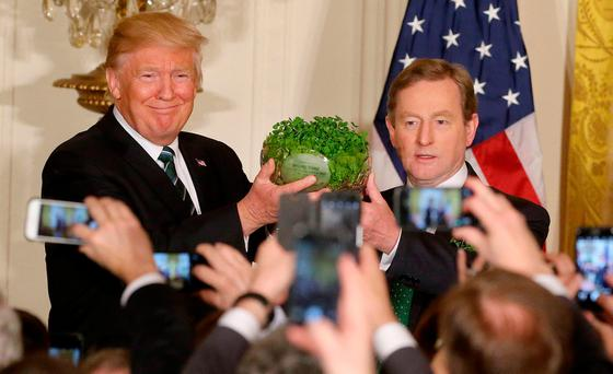 Then-Taoiseach Enda Kenny presents US President Donald Trump with a bowl of shamrock in the White House for St Patrick's Day