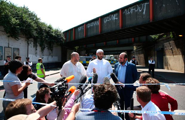 Mohammed Mahmoud (C), an Imam at Finsbury Park Mosque, gives a statement to the media at a police cordon in the Finsbury Park area of north London on June 19, 2017, following a vehicle attack on pedestrians. / AFP PHOTO / Isabel INFANTESISABEL INFANTES/AFP/Getty Images