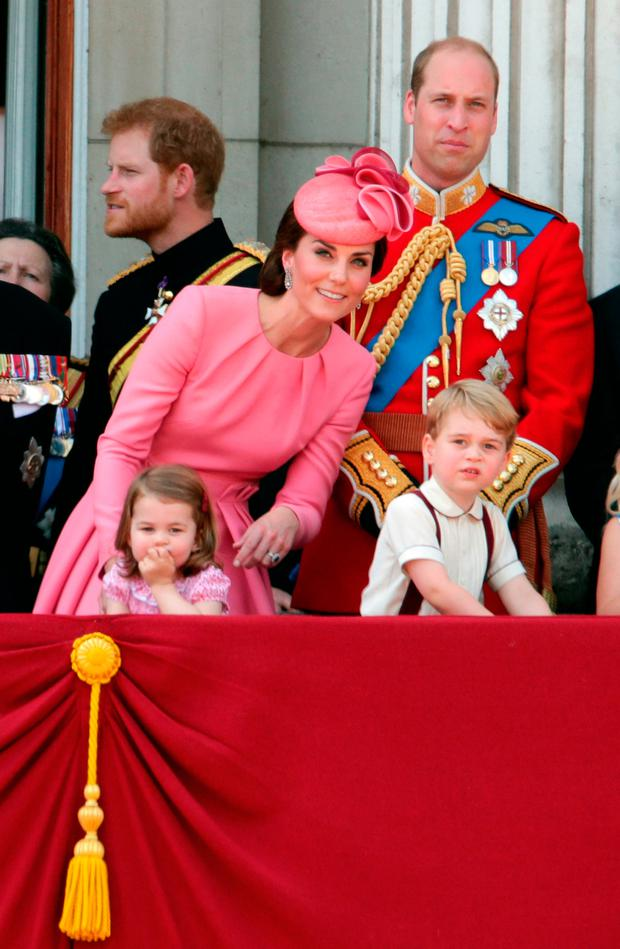 Duchess of Cambridge with Princess Charlotte and Prince George as The Duke of Cambridge and Prince Harry looks on, on the balcony of Buckingham Palace, in central London, following the Trooping the Colour ceremony