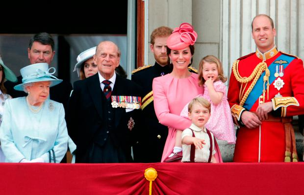 (left to right) Queen Elizabeth II, Princess Beatrice, The Duke of Edinburgh, Prince Harry, The Duchess of Cambridge holding Princess Charlotte, Prince George and The Duke of Cambridge on the balcony of Buckingham Palace, in central London, following the Trooping the Colour ceremony