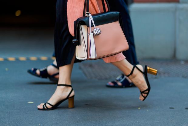 Yoyo Lu wearing salmon coloured bag, sandals is seen outside Fendi during Milan Men's Fashion Week Spring/Summer 2018 on June 19, 2017 in Milan, Italy. (Photo by Christian Vierig/Getty Images)