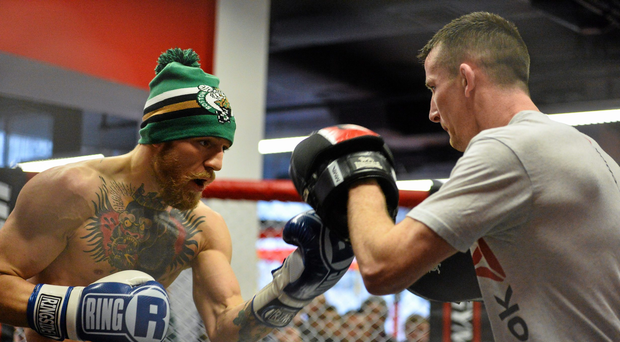 Conor McGregor, left, during an open workout session ahead of his fight against Dennis Siver in TD Garden, Boston, on Sunday. UFC Fight Night Open Workouts, UFC Gym, Boston, Massachusetts, USA. Picture credit: Ramsey Cardy / SPORTSFILE