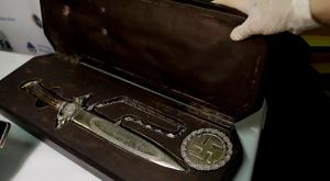 A knife with Nazi markings is seen at the Interpol headquarters in Buenos Aires, Argentina, Friday, June 16, 2017. (AP Photo/Natacha Pisarenko)