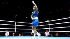 Natasha Jonas of Great Britain salutes the crowd after her victory over Quanitta Underwood of United States during the Women's Light (57-60kg) Boxing on Day 9 of the London 2012 Olympic Games at ExCeL on August 5, 2012 in London, England. (Photo by Scott Heavey/Getty Images)