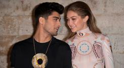 Zayn Malik and Gigi Hadid attend the Givenchy show as part of the Paris Fashion Week Womenswear Spring/Summer 2017 on October 2, 2016 in Paris, France. (Photo by Dominique Charriau/WireImage)