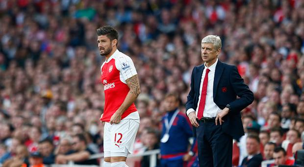 Arsene Wenger manager of Arsenal and Olivier Giroud of Arsenal look on during the Barclays Premier League match between Arsenal and Manchester United at Emirates Stadium. (Photo by Julian Finney/Getty Images)