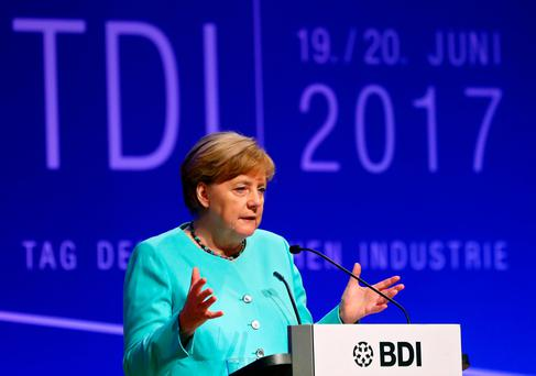 German Chancellor Angela Merkel attends the German Industry Day, hosted by the BDI industry association, in Berlin, Germany, June 20, 2017. REUTERS/Hannibal Hanschke