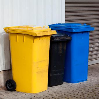 The dispute revolved around one person's rubbish being put into another person's bin (stock photo)