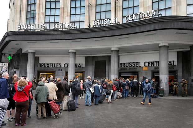 People are seen outside Brussels central station as police control access to the building in Brussels, Belgium, March 23, 2016. REUTERS/Francois Lenoir/File Photo