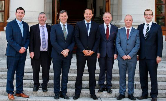 Taoiseach Leo Varadkar with, from left, Brendan Griffin, Kevin 'Boxer' Moran, Michael D'Arcy, Ciaran Cannon, Jim Daly and John Paul Phelan. Photo: Steve Humphreys