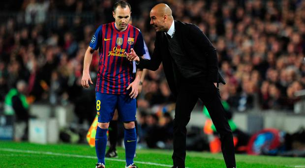 Guardiola with Andres Iniesta at Barca