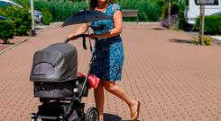 Lieke der Kinderen walks her newborn in her Bugaboo stroller in Dordrecht Monday, June 19, 2017. Picture taken June 19, 2017. REUTERS/Michael Kooren