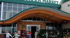 Customers are seen outside a Whole Foods Market in Dallas (Photo/LM Otero, file)