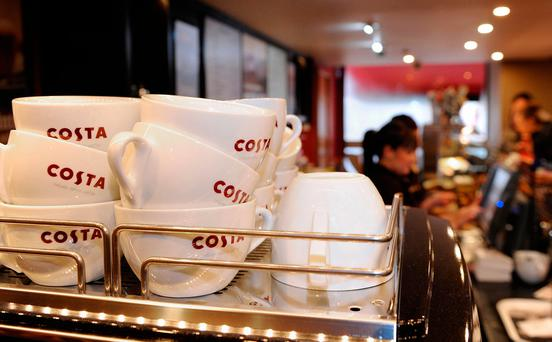 File photo dated 22/02/13 of mugs in a Costa coffee shop, as Whitbread said it had rolled out its new