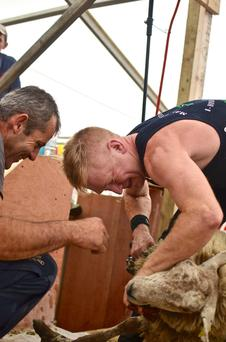 Mark McGeown (right) getting encouragement from Dwyane Black during his record setting at the County Louth Agricultural Show on June 13.