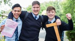 Robin Nugent, Donal Smartt and Jamie Lennon, who completed their Leaving Cert exams at Ard Scoil Rís on Griffith Avenue, Dublin. Photo: Mark Condren