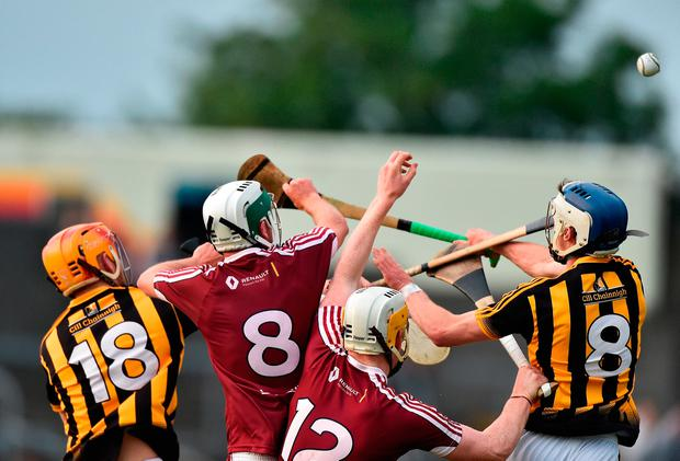 Michael Daly and Niall Mitchell of Westmeath in action against Darren Mullen and Luke Scanlon of Kilkenny. Photo by David Maher/Sportsfile