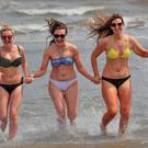 From left, Aisling Ferry, Cara Towell and Elanor Flannery from Ashbourne, Co. Meath this afternoon on Portmarnock Beach enjoying the sun....Picture Colin Keegan, Collins Dublin.