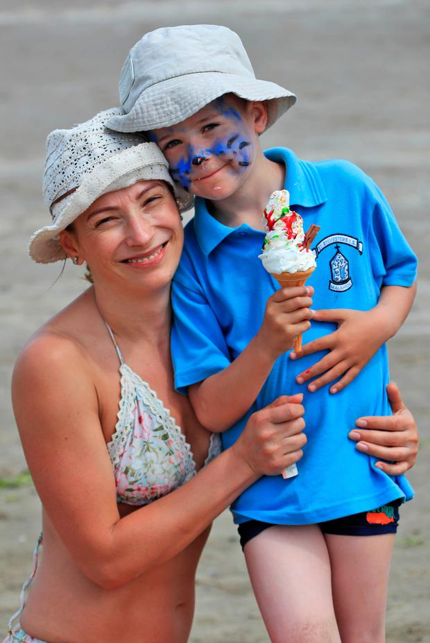 Anita and Robert (6) Bulaiu from Malahide this afternoon on Portmarnock Beach enjoying the sun and temperatures expected to reach up to 29C this afternoon....Picture Colin Keegan, Collins Dublin.