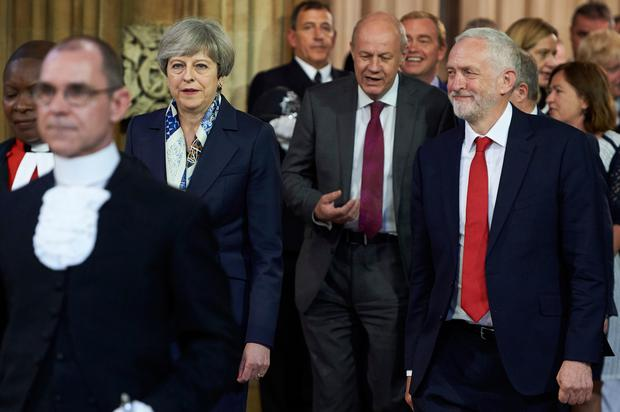 Theresa May and Jeremy Corbyn in the House of Lords yesterday. Picture: PA
