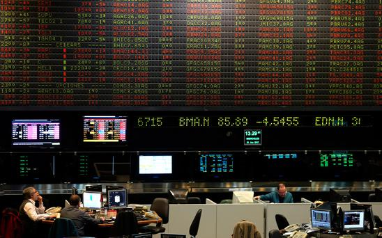 Traders work on the floor of the Buenos Aires Stock Exchange in Buenos Aires' financial district, Argentina