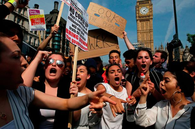 Protesters hold up placards. Photo: Getty Images