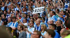Huddersfield Town fans hold up a sign saying proud after they are promoted to the Premier League after the Sky Bet Championship Play Off Final match between Reading and Huddersfield Town at Wembley Stadium on May 29, 2017 in London, England. (Photo by Catherine Ivill - AMA/Getty Images)