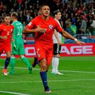 Alexis Sanchez celebrates after scoring the opening goal for Chile against Germany in the Confederations Cup last night. The game finished 1-1. Photo: Maxim Shemetov/Reuters