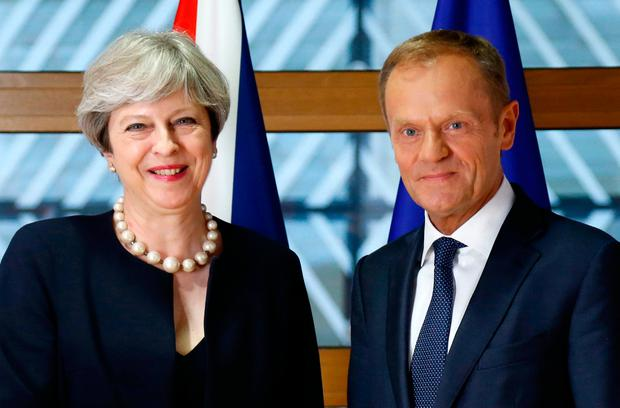 European Council President Donald Tusk, right, poses for photographers with British Prime Minister Theresa May prior to a bilateral meeting on the sidelines of an EU summit in Brussels (Francois Lenoir, Pool Photo via AP)