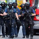 Counter-terrorism officers march near London Bridge a day after the terrorist attack earlier this month. Photo: Getty
