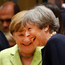 Theresa May and Angela Merkel laughing at the summit. Picture: Reuters