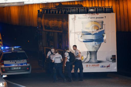 French police work near a double decker tour bus after an accident in a tunnel underpass injured tourists in Paris, France, June 23, 2017. Photo: REUTERS/Jean-Paul Pelissier