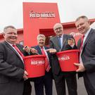 Pictured at the opening of Connelly's Red Mills new superstore in Kilkenny are Bill, Joe and Michael Connolly with E.U Commissioner Phil Hogan.