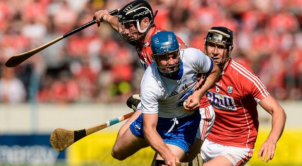 Waterford's Michael Walsh is challenged by Colm Spillane (left) and Mark Ellis of Cork during the Munster SHC semi-final at Semple Stadium. Photo by Piaras Ó Mídheach/Sportsfile