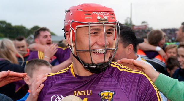 Lee Chin celebrates with delighted Wexford fans following the Leinster Championship victory over Kilkenny. Photo by Daire Brennan/Sportsfile