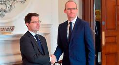 Northern Ireland Secretary James Brokenshire with Foreign Minister Simon Coveney. Photo: PA