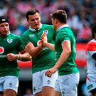 Garry Ringrose of Ireland, right, is congratulated by team-mates Luke Marshall, left, and Jacob Stockdale after scoring their side's first try