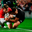 Elliot Daly of the British & Irish Lions is tackled by Israel Dagg of New Zealand