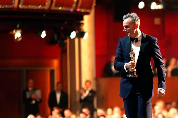 Actor Daniel Day-Lewis accepts the Best Actor award for 'Lincoln,' seen from backstage during the Oscars held at the Dolby Theatre on February 24, 2013 in Hollywood, California. (Photo by Christopher Polk/Getty Images)