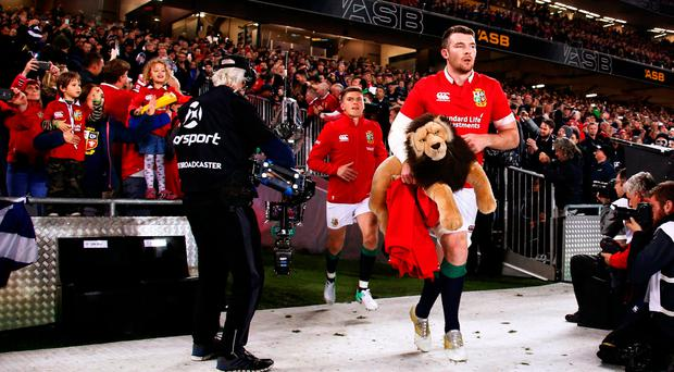 Lions' Peter O'Mahony runs onto the pitch with the mascot