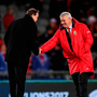 British & Irish Lions head coach Warren Gatland, right, shakes hands with New Zealand head coach Steve Hansen