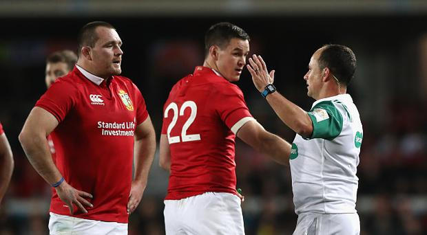 Jonathan Sexton and Ken Owens (L) talk to referee Jaco Peyer during the Test match between the New Zealand All Blacks and the British & Irish Lions at Eden Park on June 24, 2017 in Auckland, New Zealand. (Photo by David Rogers/Getty Images)
